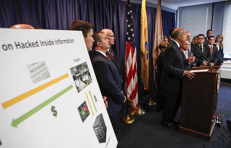 Secretary of Homeland Security Jeh Johnson speaks during a press conference next to Securities and Exchange Commission Chair Mary Jo White (R) on August 11, 2015 in Newark, New Jersey (AFP Photo/Kena Betancur)