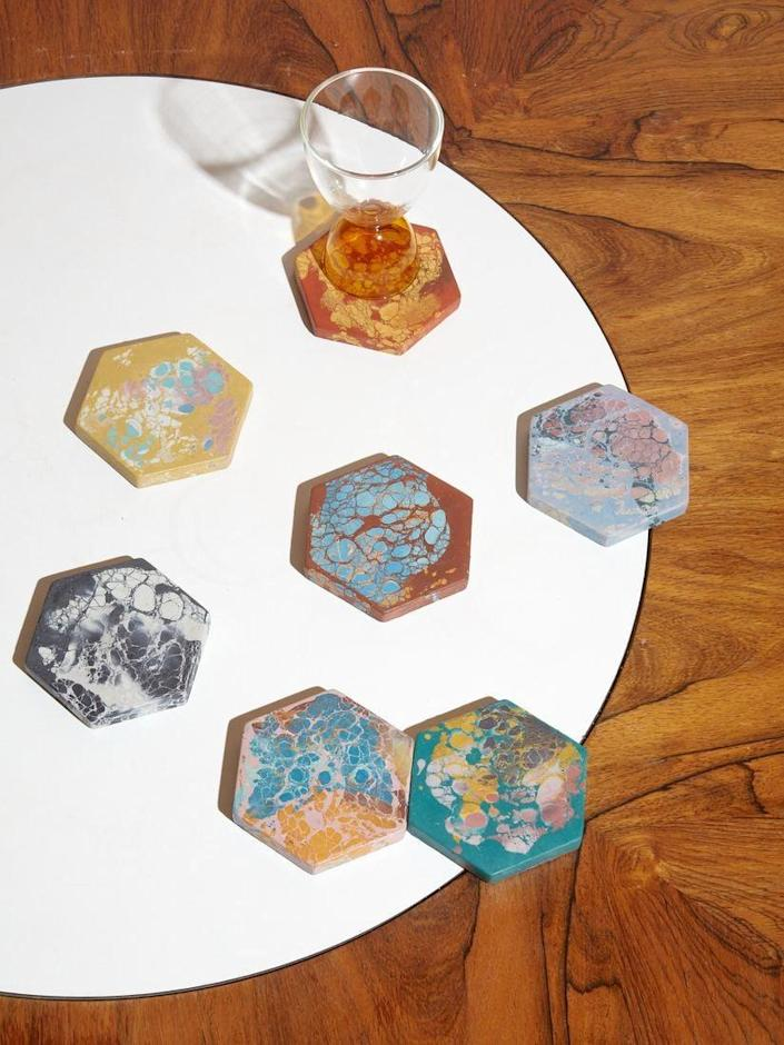 <p>Protect your wooden surfaces with these eye-catching, hand casted <span>Oracle Hex Coasters</span> ($22 each). The patterning is uniquely stunning.</p>