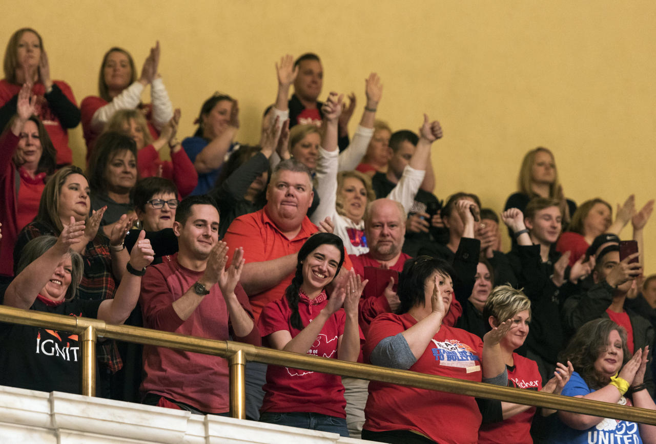 <p>Teachers and school personnel celebrate after the state Senate approved a bill to increase state workers pay across the board by 5 percent at the capitol in Charleston, W.Va., on Tuesday, March 6, 2018. (Photo: Charleston Gazette-Mail via AP) </p>