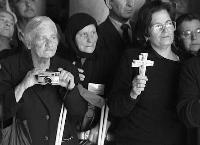 <p>Greek Orthodox pilgrims stand prepared to witness the Good Friday procession led by Greek Orthodox Patriarch Diodoros I, inside the Church of the Holy Sepulcher, traditionally believed to be the site of Jesus Christ's crucifixion and burial, April 16, 1993, in Jerusalem's Old City. (Photo: Jacqueline Larma/AP) </p>