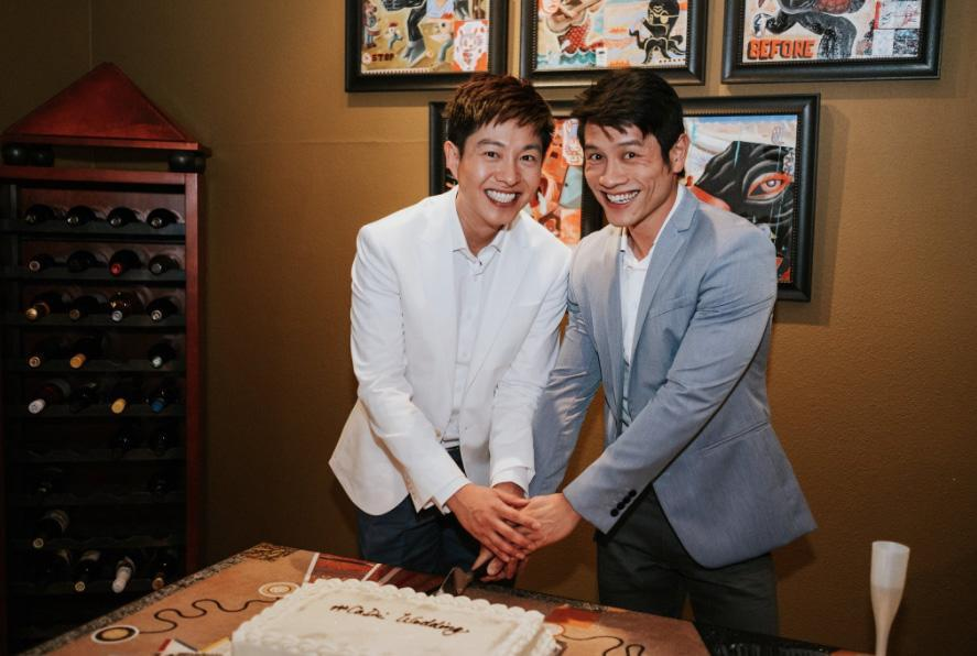 Goh (left) and his husband at their wedding reception. (Photo: Caleb Goh/Twitter)