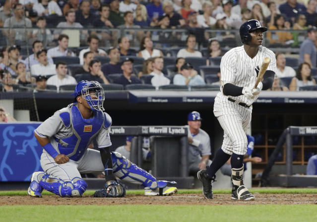 New York Yankees' Didi Gregorius watches his three-run home run during the fourth inning of a baseball game, next to Kansas City Royals catcher Salvador Perez on Thursday, July 26, 2018, in New York. (AP Photo/Frank Franklin II)