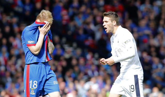 "Football - Falkirk v Inverness Caledonian Thistle - William Hill Scottish FA Cup Final - Hampden Park, Glasgow, Scotland - 30/5/15 Inverness Caledonian Thistle's Carl Tremarco (L) looks dejected after being sent off Reuters / Russell Cheyne Livepic EDITORIAL USE ONLY. No use with unauthorized audio, video, data, fixture lists, club/league logos or ""live"" services. Online in-match use limited to 45 images, no video emulation. No use in betting, games or single club/league/player publications. Please contact your account representative for further details."