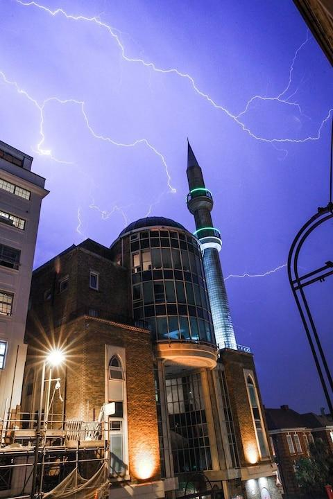 Lightning over the the Suleymaniye Mosque in Dalston, east London - Credit: Andrew Lanxon Hoyle/@Batteryhq