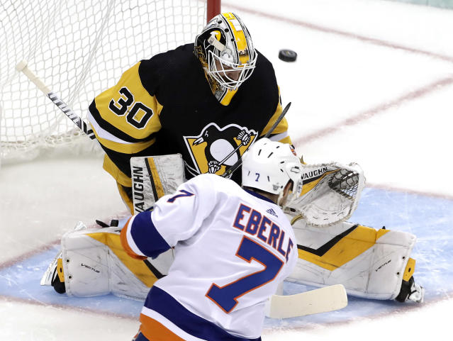 New York Islanders' Jordan Eberle (7) puts a shot past Pittsburgh Penguins goaltender Matt Murray (30) for a goal during the first period in Game 4 of an NHL first-round hockey playoff series in Pittsburgh, Tuesday, April 16, 2019. (AP Photo/Gene J. Puskar)