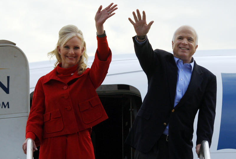 U.S. Republican presidential nominee Senator John McCain (R-AZ) (R) and his wife Cindy wave from the door of their campaign plane as they arrive for an airport hangar campaign rally in Moon Township, Pennsylvania November 3, 2008. Senator McCain is scheduled to make campaign appearances in seven states on the final day before the election. REUTERS/Brian Snyder (UNITED STATES) US PRESIDENTIAL ELECTION CAMPAIGN 2008 (USA)