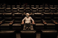 FILE - In this Sept. 8, 2020, file photo, Karen Speros, 82, waits for a movie to start at a Regal movie theater in Irvine, Calif. (AP Photo/Jae C. Hong, File)