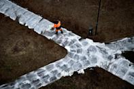 A municipal worker cleans and disinfects walkways in a yard in Moscow, during the strict lockdown in Russia
