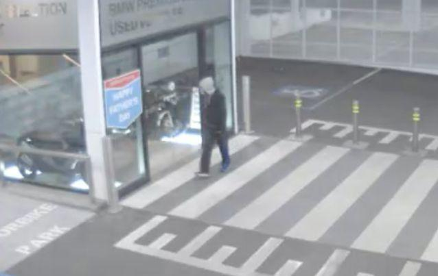 The bandit can be seen lurking around the dealership before stealing the motorbike, parked temporarily in a lift. Photo: Victoria Police