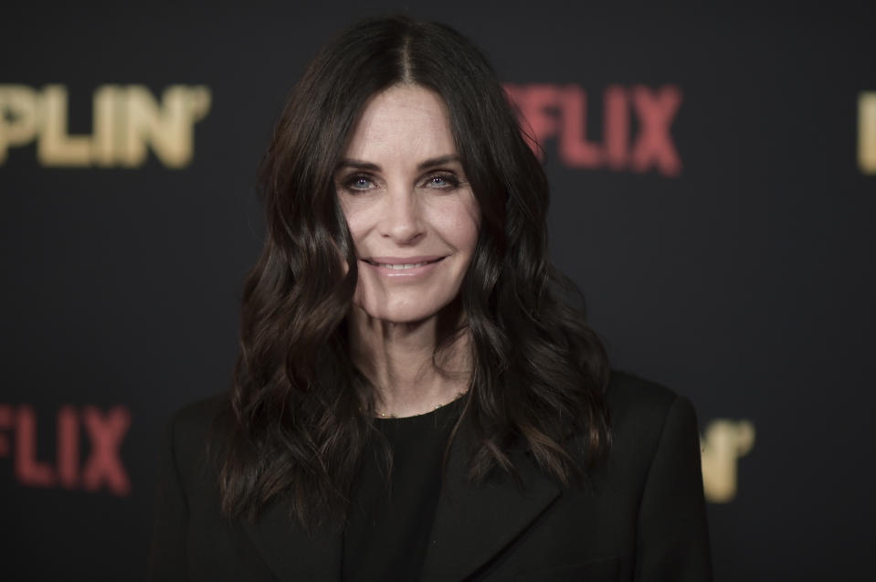 """Courteney Cox attends the world premiere of """"Dumplin'"""" at TCL Chinese Theatre on Thursday, Dec. 6, 2018, in Los Angeles. (Photo by Richard Shotwell/Invision/AP)"""