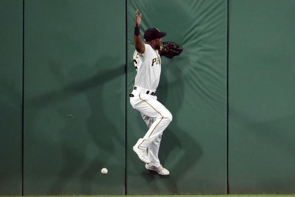 Pittsburgh Pirates center fielder Starling Marte can't handle a two-run double off the wall by St. Louis Cardinals' Paul DeJong during the seventh inning of a baseball game in Pittsburgh, Saturday, Sept. 7, 2019. (AP Photo/Gene J. Puskar)