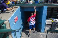 Joey Chestnut taps the stands for good luck before prepping inside at the Nathan's Famous Fourth of July International Hot Dog-Eating Contest in Coney Island's Maimonides Park on Sunday, July 4, 2021, in New York. (AP Photo/Brittainy Newman)