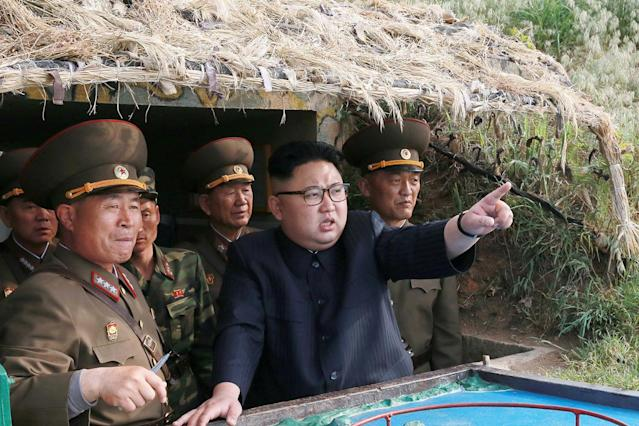 <p>North Korean leader Kim Jong Un inspects the defence detachment on Jangjae Islet and the Hero Defence Detachment on Mu Islet located in the southernmost part of the waters off the southwest front, in this undated photo released by North Korea's Korean Central News Agency (KCNA) on May 5, 2017. (Photo: KCNA/ via REUTERS) </p>
