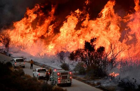 FILE PHOTO: Firefighters attack the Thomas Fire's north flank with backfires as they fight a massive wildfire north of Los Angeles, near Ojai , California, U.S., Dec. 9, 2017.  REUTERS/Gene Blevins/File Photo