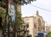 A picture of Syria's President Bashar al-Assad is pictured outside the parliament building in Damascus