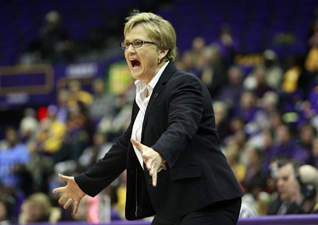 Tennessee head coach Holly Warlick shouts from the bench in the first half of an NCAA college basketball game against LSU in Baton Rouge, La., Thursday, Feb. 27, 2014. (AP Photo/Tim Mueller)
