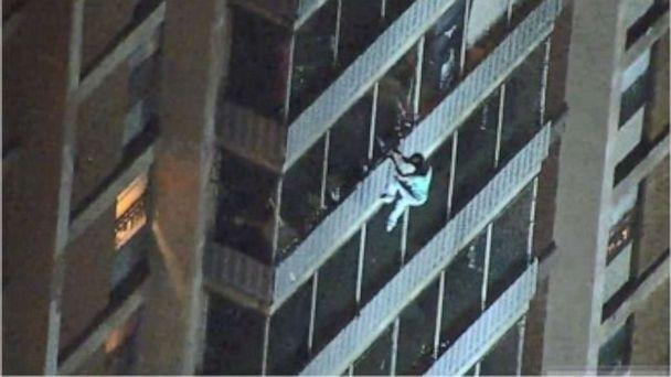 PHOTO: A man is seen climbing down a 19-story high-rise during a fire Thursday night in Philadelphia. He escaped unharmed. (WPVI)