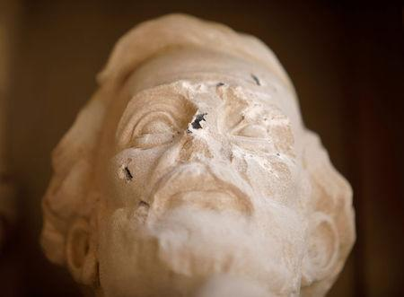 Damage done to the face of a statue of Confederate commander General Robert E. Lee is seen, at Duke University's Duke Chapel in Durham, North Carolina, U.S. on August 17, 2017. REUTERS/Jonathan Drake