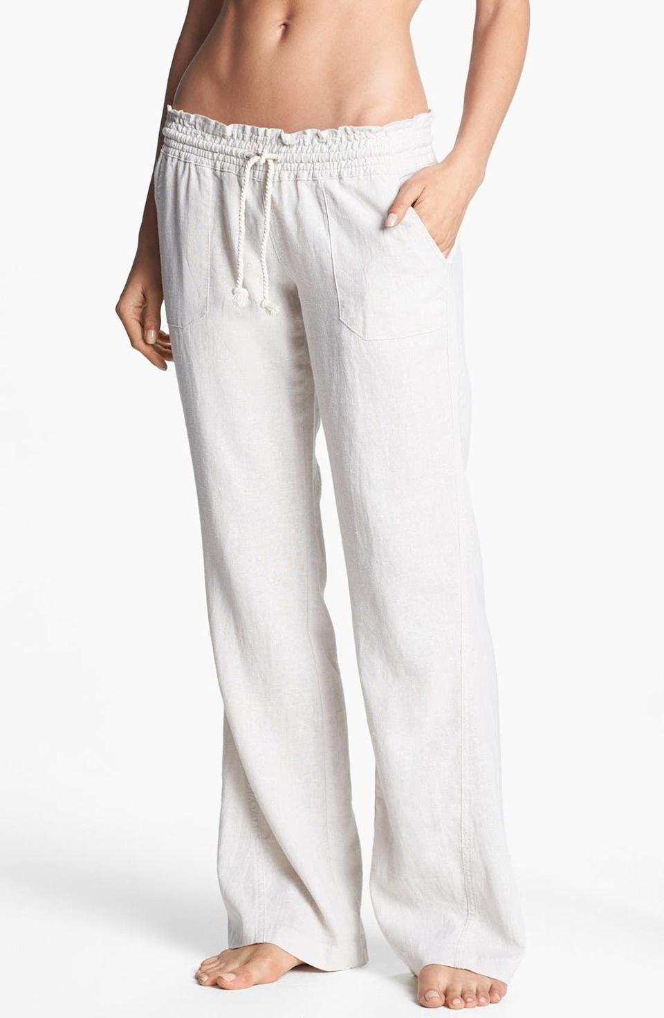 """<p><strong>Roxy </strong></p><p>nordstrom.com</p><p><strong>$39.50</strong></p><p><a href=""""https://go.redirectingat.com?id=74968X1596630&url=https%3A%2F%2Fwww.nordstrom.com%2Fs%2Froxy-oceanside-linen-blend-beach-pants%2F5634652&sref=https%3A%2F%2Fwww.townandcountrymag.com%2Fstyle%2Ffashion-trends%2Fg27681571%2Fbest-beach-coverups%2F"""" rel=""""nofollow noopener"""" target=""""_blank"""" data-ylk=""""slk:Shop Now"""" class=""""link rapid-noclick-resp"""">Shop Now</a></p><p>Don a relaxed pair of drawstring linen beach pants with a bucket hat and bandeau top and you have the perfect laidback outfit for a day of fun in the sun.</p><p><strong>MORE:</strong> <a href=""""https://www.townandcountrymag.com/style/fashion-trends/g35937397/best-linen-pants/"""" rel=""""nofollow noopener"""" target=""""_blank"""" data-ylk=""""slk:Stylish Linen Pants for Women"""" class=""""link rapid-noclick-resp"""">Stylish Linen Pants for Women </a></p>"""