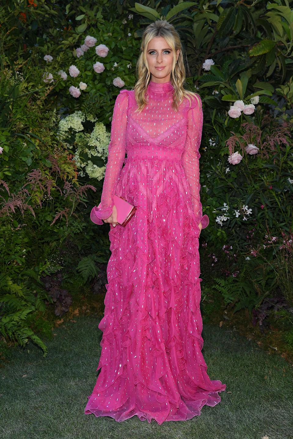 <p>Nicky Hilton chose fuchsia-hued ethereal gown for the Valentino haute couture show on 4 July. <em>[Photo: Getty]</em> </p>