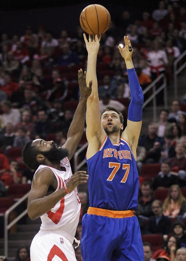 New York Knicks center Andrea Bargnani (77) shoots over Houston Rockets guard James Harden (12) during the second period of an NBA basketball game, Friday, Jan. 3, 2014, in Houston. (AP Photo/Patric Schneider)