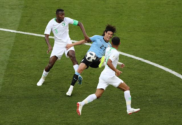 Soccer Football - World Cup - Group A - Uruguay vs Saudi Arabia - Rostov Arena, Rostov-on-Don, Russia - June 20, 2018 Uruguay's Edinson Cavani in action with Saudi Arabia's Osama Hawsawi and Abdullah Otayf REUTERS/Marcos Brindicci
