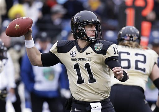 Vanderbilt quarterback Jordan Rodgers (11) passes against North Carolina State in the first quarter of the Music City Bowl NCAA college football game on Monday, Dec. 31, 2012, in Nashville, Tenn. (AP Photo/Mark Humphrey)