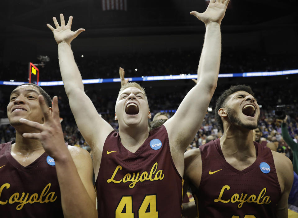 Loyola-Chicago's Lucas Williamson, Nick Dinardi and Loyola-Chicago Christian Negron, from left, celebrate winning a regional final NCAA college basketball tournament game against Kansas State, Saturday, March 24, 2018, in Atlanta. Loyola-Chicago won 78-62. (AP Photo/David Goldman)