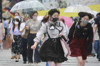 People wearing face masks to protect against the spread of the coronavirus walk on a crossing in Tokyo Tuesday, Aug. 17, 2021. Japan's coronavirus state of emergency will continue through Sept. 12 rather than finishing at the end of this month as initially planned, the government decided Monday. (AP Photo/Koji Sasahara)