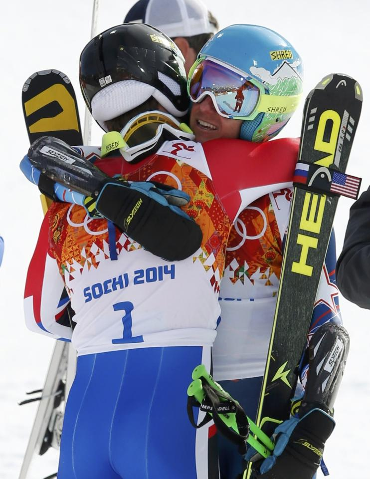Winner Ted Ligety of the U.S. (R) hugs third-placed France's Alexis Pinturault after the second run of the men's alpine skiing giant slalom event in the Sochi 2014 Winter Olympics at the Rosa Khutor Alpine Center February 19, 2014. REUTERS/Mike Segar (RUSSIA - Tags: OLYMPICS SPORT SKIING)