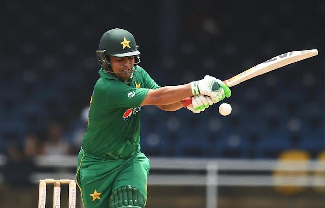 Pakistan's Kamran Akmal plays a shot during the third of four-T20I-match between West Indies and Pakistan at the Queen's Park Oval in Port of Spain, Trinidad, on April 1, 2017 (AFP Photo/Jewel SAMAD)