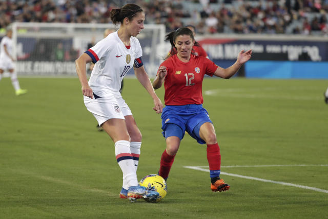 U.S. forward Carli Lloyd, left, works for possession against Costa Rica defender Lixy Rodriguez (12) during the first half of an international friendly soccer match Sunday, Nov. 10, 2019, in Jacksonville, Fla. (AP Photo/John Raoux)