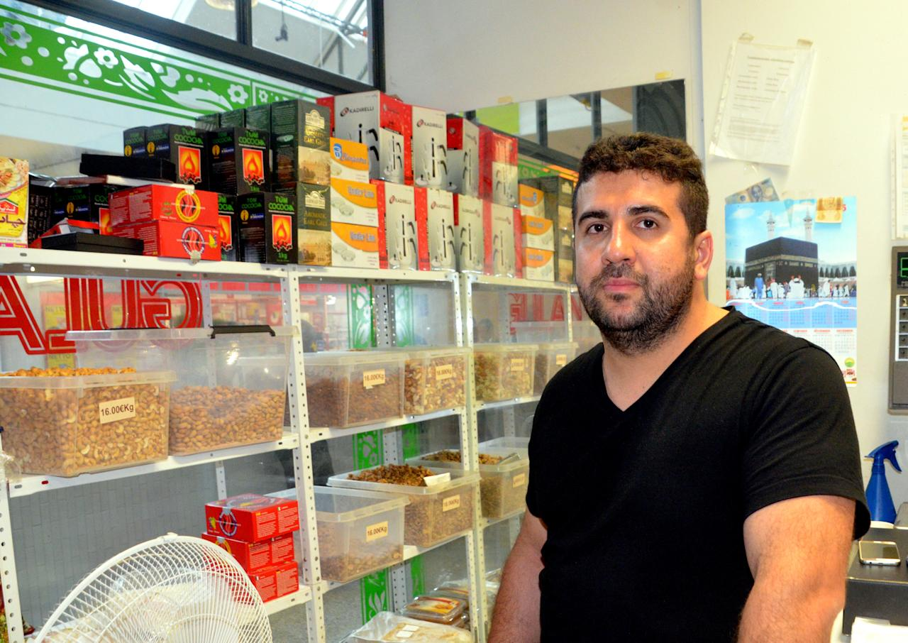 FILE PHOTO: Kamaran Azamifar, a grocery shopkeeper at a shopping centre, poses for a picture at his store in Turku, Finland August 19, 2017. REUTERS/Tuomas Forsell/File Photo