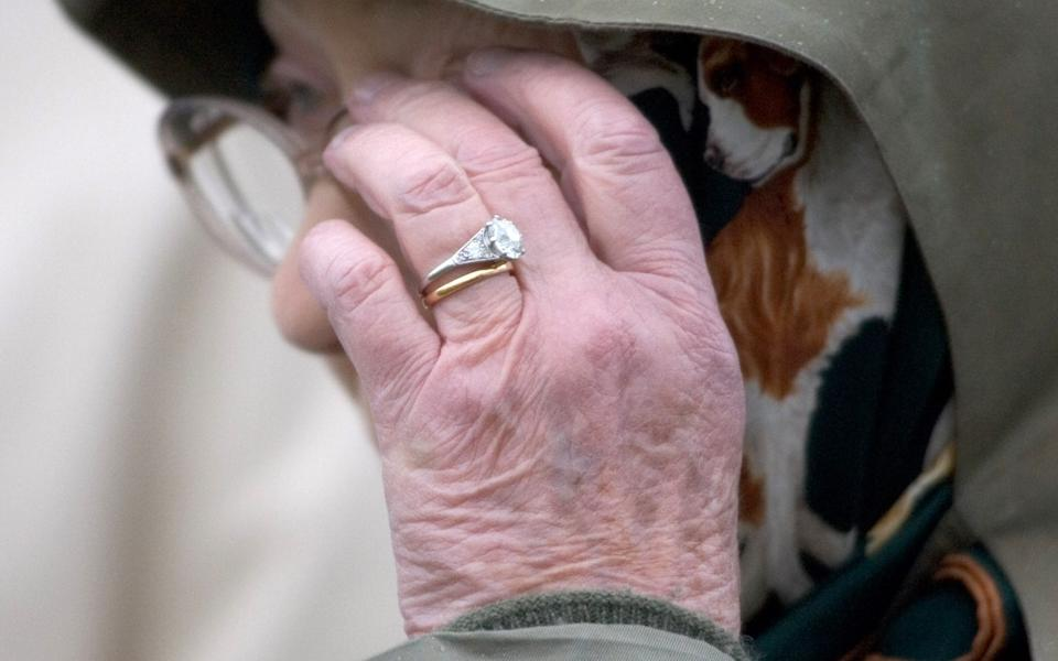 The Queen wearing her diamond engagement ring and Welsh-gold wedding band - Antony Jones/UK Press via Getty Images