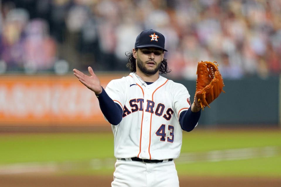 Houston Astros starting pitcher Lance McCullers Jr. reacts after getting Texas Rangers' Willie Calhoun to pop out during the sixth inning of a baseball game Wednesday, Sept. 16, 2020, in Houston. (AP Photo/David J. Phillip)