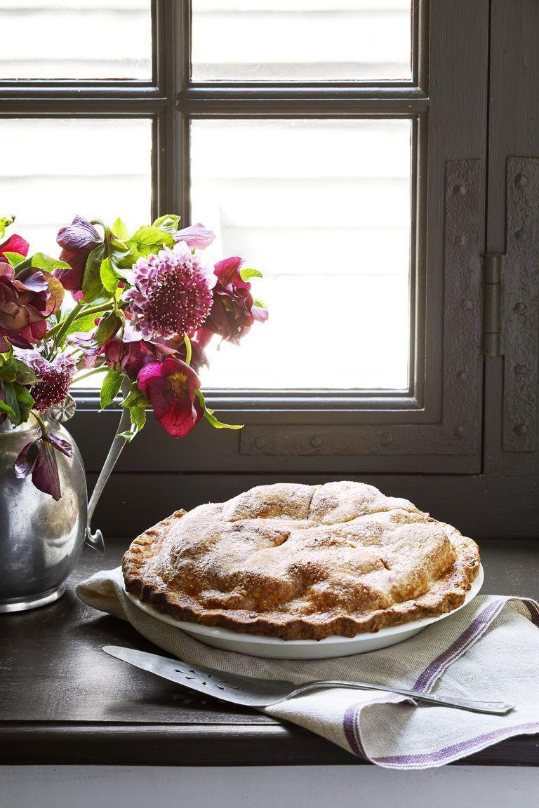 """<p>The apple and Cheddar combination of this crowd-pleasing pie is perfect for both guests who are sugar lovers and guests who prefer savory tastes.</p><p><strong><a href=""""https://www.countryliving.com/food-drinks/a29146759/nancy-fuller-double-crust-apple-cheddar-pie/"""" rel=""""nofollow noopener"""" target=""""_blank"""" data-ylk=""""slk:Get the recipe"""" class=""""link rapid-noclick-resp"""">Get the recipe</a>.</strong> </p>"""