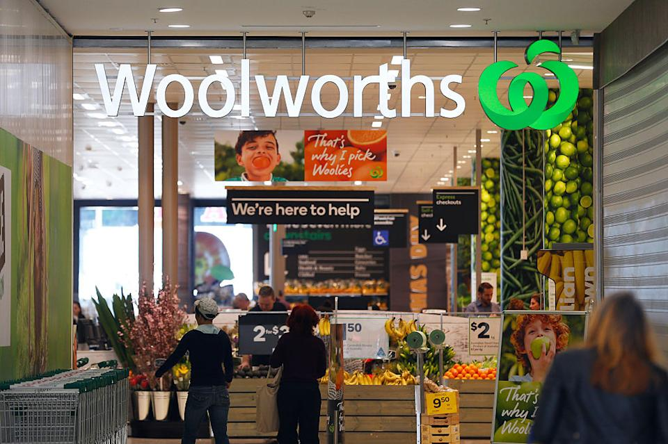 Customers stand outside a Woolworths store.