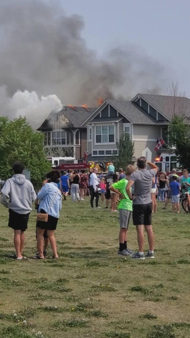 A two alarm house fire in southeast Calgary displaced seven residents from their homes. (Tracey McKeen Photography - image credit)