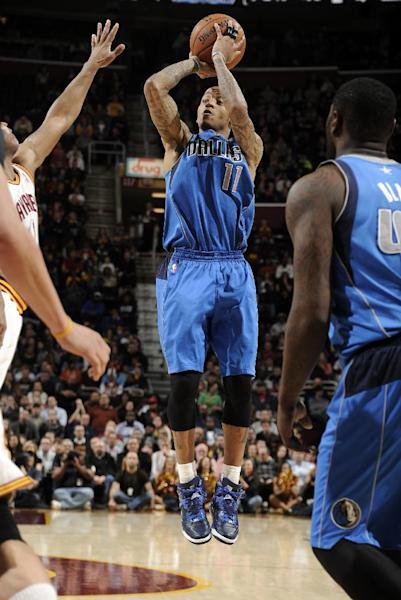 CLEVELAND, OH - JANUARY 20: Monta Ellis #11 of the Dallas Mavericks shoots against the Cleveland Cavaliers at The Quicken Loans Arena on January 20, 2014 in Cleveland, Ohio. (Photo by David Liam Kyle/NBAE via Getty Images)