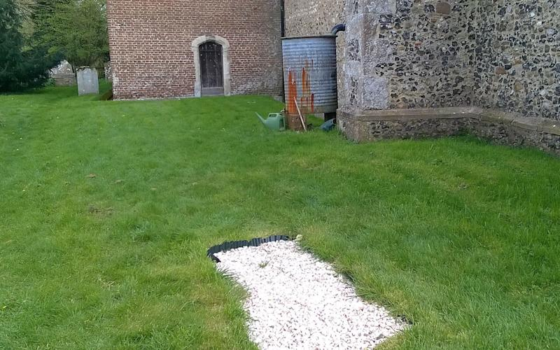 The mystery grave appeared overnight in a Hertfordshire churchyard - PA