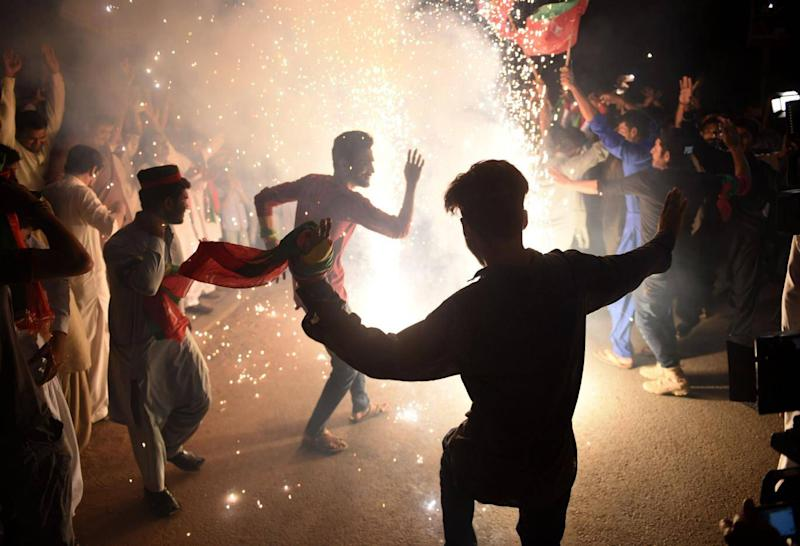 Supporters of Pakistan's cricketer-turned-politician celebrate his election in July (AFP/Getty)