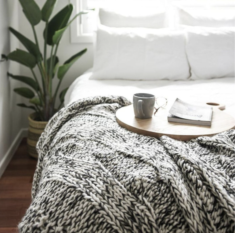 Bed with throw