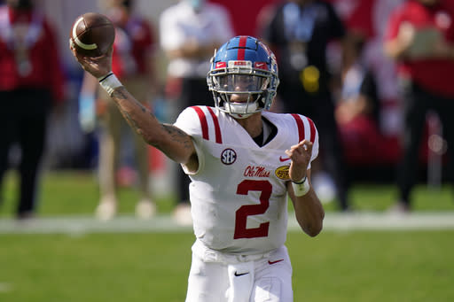 Mississippi quarterback Matt Corral throws a pass against Indiana during the first half of the Outback Bowl NCAA college football game Saturday, Jan. 2, 2021, in Tampa, Fla. (AP Photo/Chris O'Meara)
