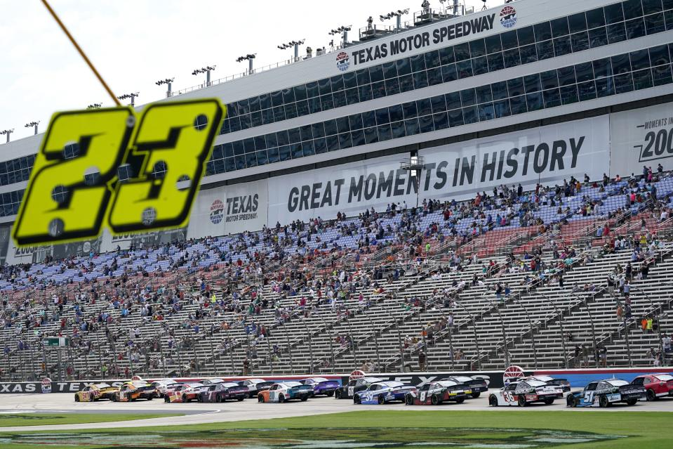 Drivers head down the front stretch during a NASCAR Xfinity Series auto race at Texas Motor Speedway in Fort Worth, Texas, Saturday, June 12, 2021. (AP Photo/Tony Gutierrez)