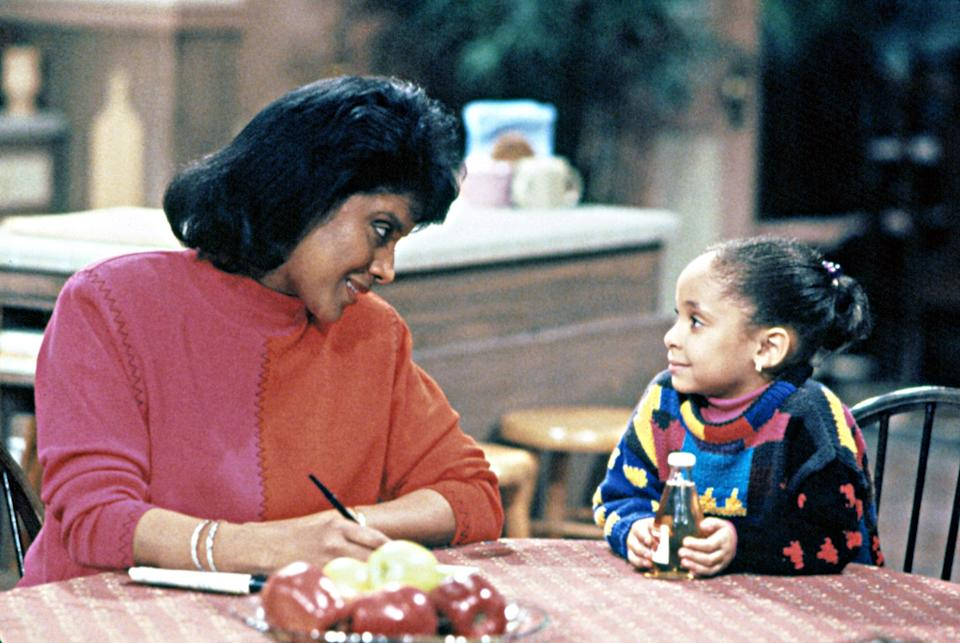 """It's impossible to talk about <em>The Cosby Show</em> now without <a href=""""https://www.glamour.com/story/in-their-own-words-these-are-the-women-who-took-down-bill-cosby?mbid=synd_yahoo_rss"""" rel=""""nofollow noopener"""" target=""""_blank"""" data-ylk=""""slk:the shadow of Bill Cosby"""" class=""""link rapid-noclick-resp"""">the shadow of Bill Cosby</a>, but the indelible legacy of Clair Huxtable still deserves recognition. <a href=""""https://www.youtube.com/watch?v=i1FRVXBC2Zo"""" rel=""""nofollow noopener"""" target=""""_blank"""" data-ylk=""""slk:Clair Huxatable deserves her things!"""" class=""""link rapid-noclick-resp"""">Clair Huxatable deserves her things!</a> Phylicia Rashad played the dynamic Mrs. Huxtable, a loving mother, devoted wife, and fierce lawyer. Her iconic catchphrase, """"let the record show,"""" was a stunning combination that showed both her expertise as seasoned lawyer and a mother of five. Clair and her daughters—traditional Sondra, free-spirited Denise, middling Vanessa, and willful Rudy—each represented different possibilities for Black women in the '80s and '90s."""