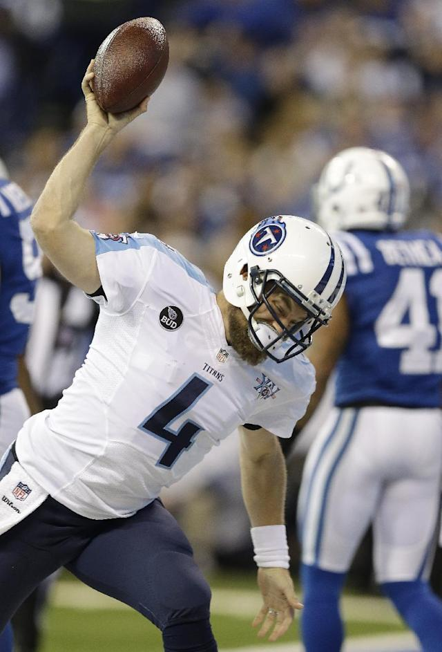 Tennessee Titans' Ryan Fitzpatrick (4) celebrates after scoring on a 1-yard touchdown run during the first half of an NFL football game against the Indianapolis Colts Sunday, Dec. 1, 2013, in Indianapolis. (AP Photo/Michael Conroy)