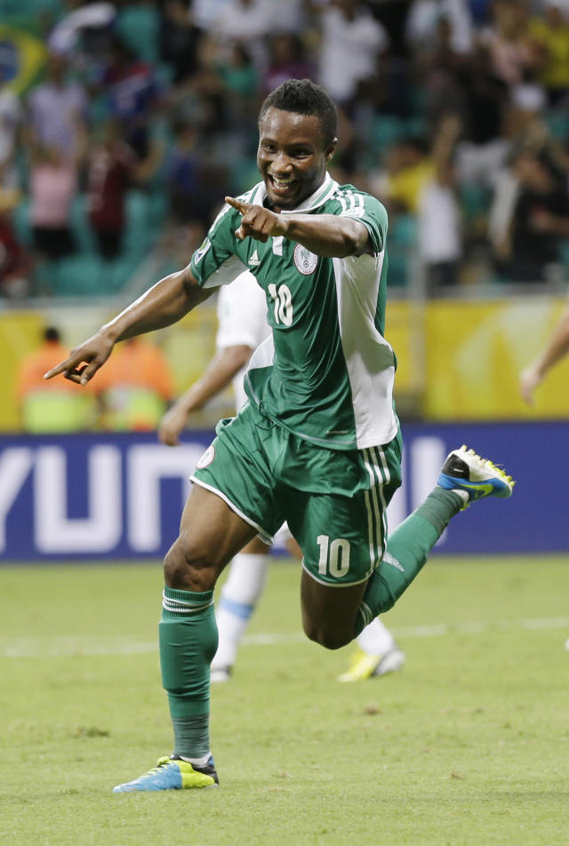 FILE - In this Vincent Enyeama, file photo, Nigeria's John Obi Mikel celebrates scoring his side's first goal during the soccer Confederations Cup group B match between Nigeria and Uruguay at Fonte Nova stadium in Salvador, Brazil. After impressing on their way to the second round in each of their first two FIFA World Cup appearances, 1994 and 1998, Nigeria have struggled since: going out at the group stage three times while taking just two points from their last eight matches in the finals. (AP Photo/Natacha Pisarenko,File)