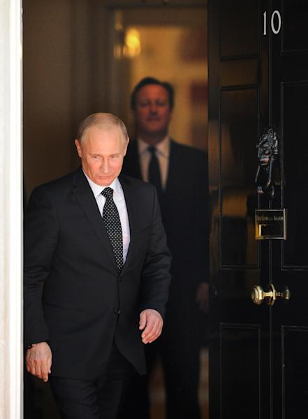 British Prime Minister David Cameron, right, leaves with Russian President Vladimir Putin after a press conference at 10 Downing Street, London, Sunday June 16, 2013. Cameron meets with Russian President Putin for talks on the Syrian crisis amid fears that differences between Moscow and the West are pushing the two sides towards a new Cold War. (AP/Anthony Devlin, PA Wire) UK OUT - NO SALES - NO ARCHIVES