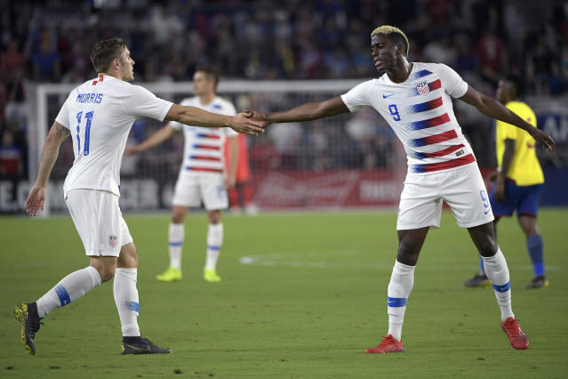 United States forwards Jordan Morris (11) and Gyasi Zardes (9) congratulate each other after a play during the first half of an international friendly soccer match Thursday, March 21, 2019, in Orlando, Fla. (AP Photo/Phelan M. Ebenhack)