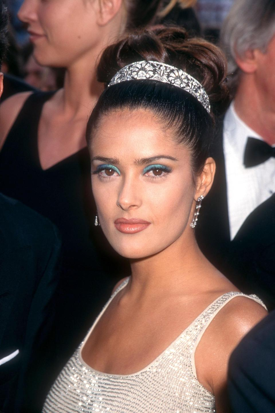 """It just takes one person to start a trend, and when Salma Hayek arrived at the Oscars in a diamond tiara, it kick-started a revival in hair jewelry. """"Everybody told me that I was crazy and ridiculous, and it was going to be pretentious,"""" Hayek <a href=""""https://www.vogue.com/article/salma-hayek-life-in-looks-best-fashion-moments-video?mbid=synd_yahoo_rss"""" rel=""""nofollow noopener"""" target=""""_blank"""" data-ylk=""""slk:told Vogue earlier this year."""" class=""""link rapid-noclick-resp"""">told <em>Vogue</em> earlier this year.</a> """"I wore the tiara anyway, and you know what happened? Everybody started wearing a tiara after that."""""""